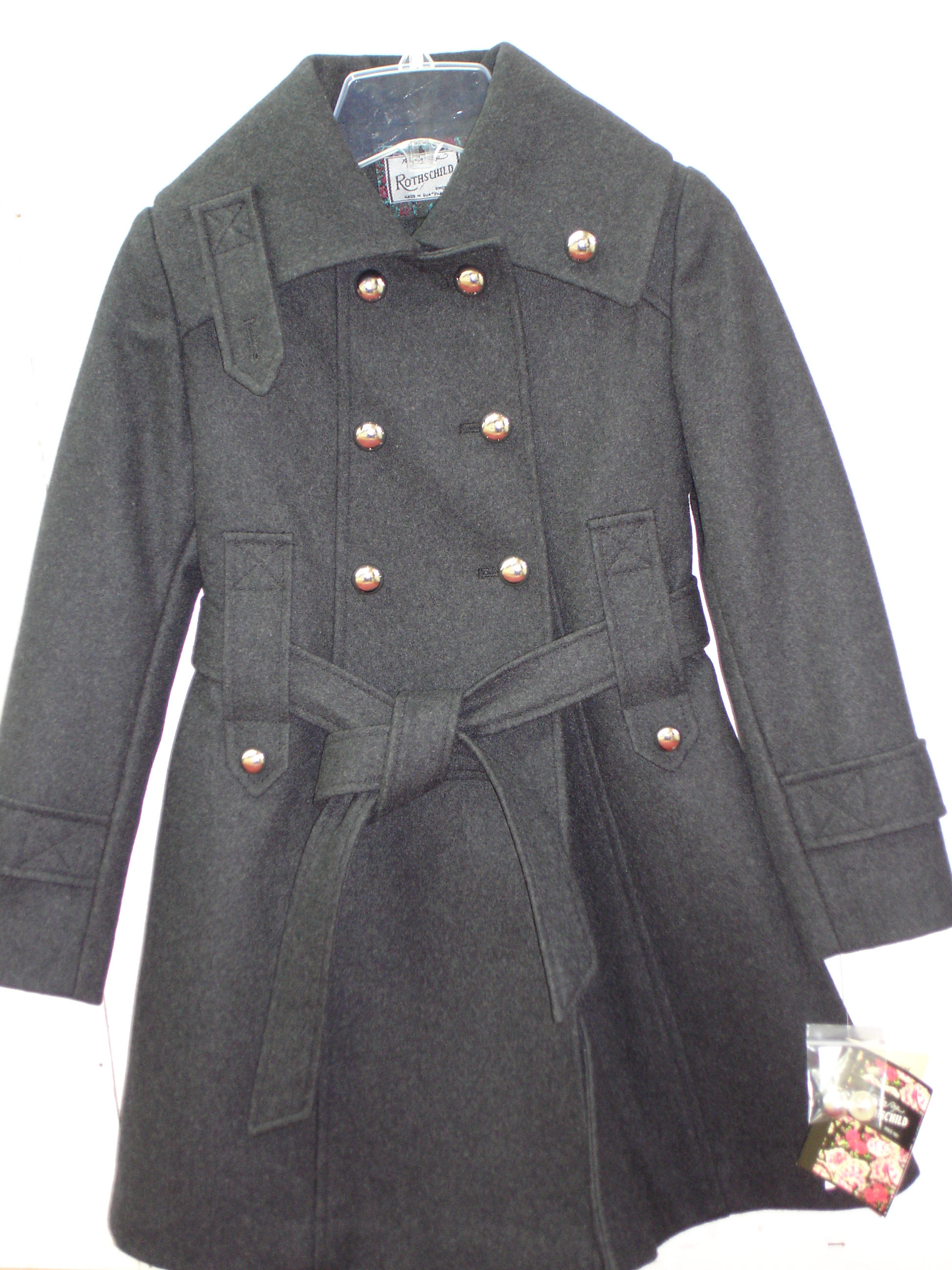 Row button coat has metallic colored buttons this rothschild coat