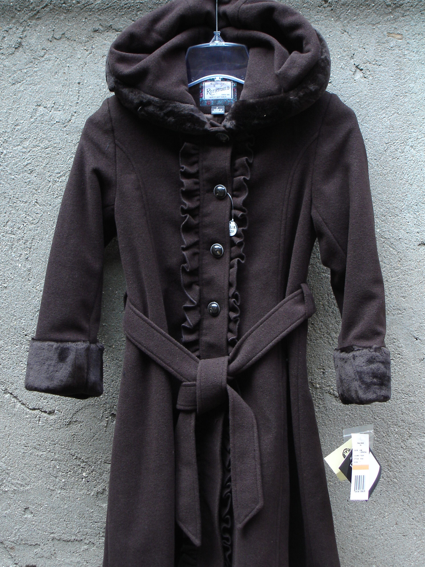 191206be5b61 These stylish wool girls coats are very fashionable this year. This warm  coat is offered in brown. This girl s coat has fur trim